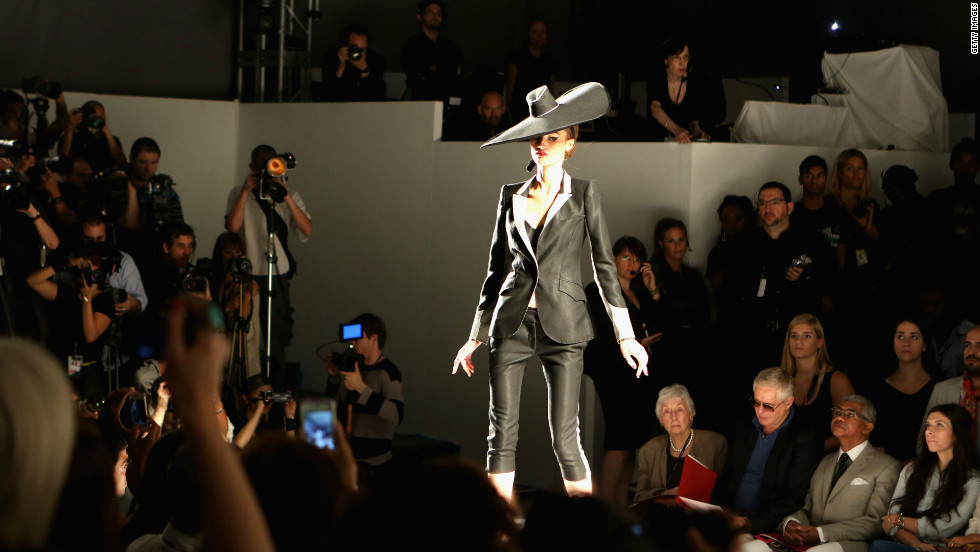 A model at the Norisol Ferrari show. Ferrari is known to favor menswear-inspired silhouettes and classic styles.