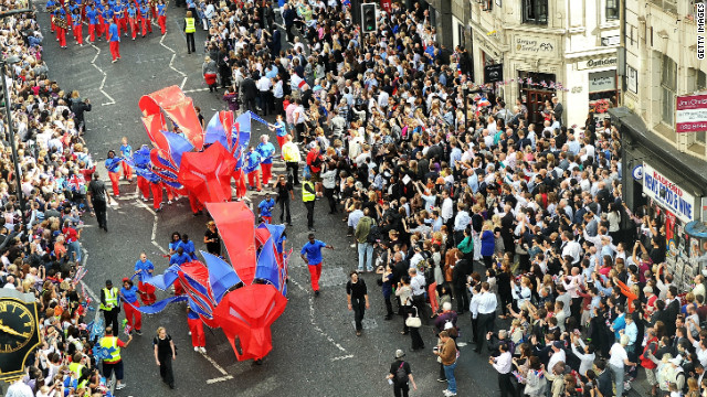 The Victory Parade progresses along Fleet Street, London.
