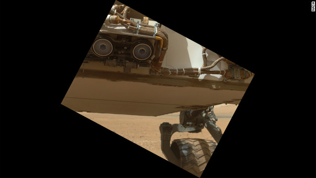 This view of the lower front and underbelly areas of NASA's Mars rover Curiosity was taken by the rover's Mars Hand Lens Imager on Sunday. Also visible are the hazard avoidance cameras on the front of the rover.