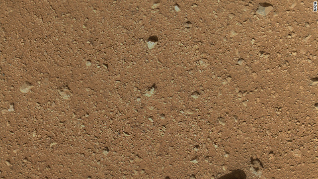The reclosable dust cover on Curiosity's Mars Hand Lens Imager was opened for the first time on Saturday, September 8, enabling MAHLI to take this image.