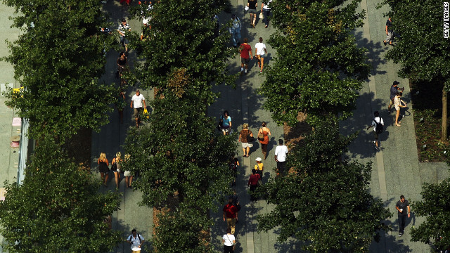 Visitors walk through the grounds of the National September 11 Memorial &amp; Museum on Friday.