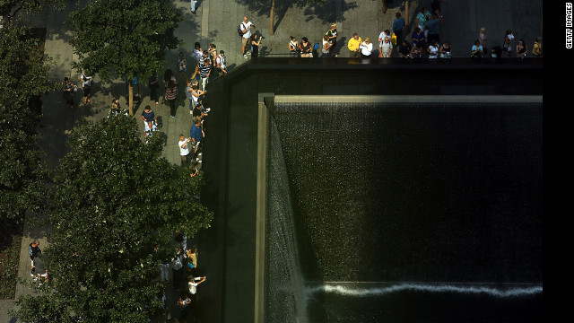 Visitors view the National September 11 Memorial &amp; Museum on Friday. The memorial was completed in time for the 10th anniversary last year. 