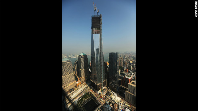 The progress of the construction on One World Trade Center can be seen in this photo, as well as one of the pools of the memorial site below.