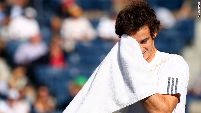 Andy Murray of Great Britain wipes his face with a towel during his men's singles final match against Novak Djokovic of Serbia on Monday.