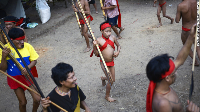 Yanomami natives perform a ritual dance at an Irotatheri community, located in southern Venezuela near the border with Brazil, on September 7. The Venezuelan government on Friday agreed to lead a delegation of national and international media to the area after reports of a masscre. They reported no evidence that such an attack had taken place.<br/><br/>