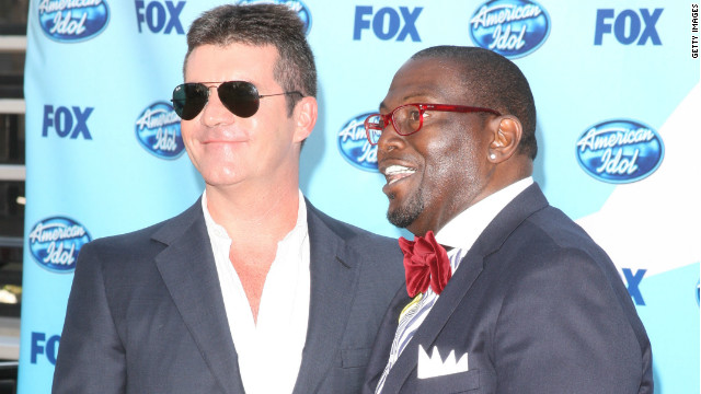 Simon Cowell and Randy Jackson are shown at the