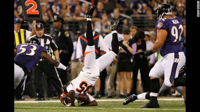 Wide receiver Armon Binns is upended after catching a pass against the Baltimore Ravens on Monday.
