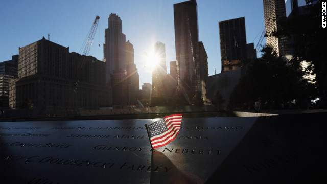 A flag sits in a name on the 9/11 Memorial on Tuesday, September 11 before ceremonies marking the eleventh anniversary of the terrorist attacks begin.