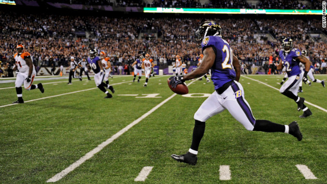 Safety Ed Reed of the Baltimore Ravens returns an interception for a touchdown in the third quarter against the Cincinnati Bengals on Monday.