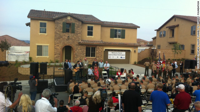 Juan Dominguez is presented with a fully automated 'smart' home by the Stephen Siller Tunnel to Towers Foundation and its partner, the Gary Sinise Foundation.