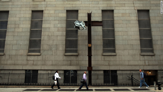 Pedestrians walk by the cross where it was mounted on Church Street in Lower Manhattan on September 11, 2008.
