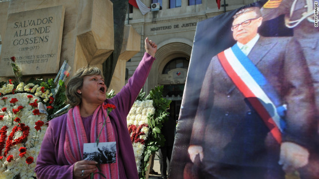 A woman shouts slogans during the commemoration of Allende's 100th birthday anniversary in Santiago on June 26, 2008.