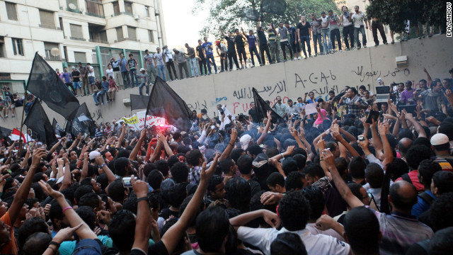 Protesters climb U.S. Embassy walls in Cairo