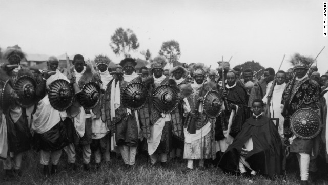 A group of soldiers from the army of Abyssinia (modern Ethiopia) is pictured with reinforced shields and rifles during the war with Mussolini-led Italy. Italy would take Addis Ababa and annex Abyssinia on May 9, 1936, after its emperor, Haile Selassie, flees.