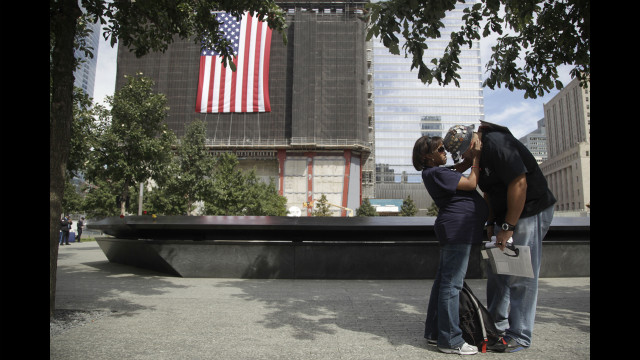 Jillian Suarez, left, consoles Eloy Suarez during observances of the anniversary of the 9/11 attacks on Tuesday.