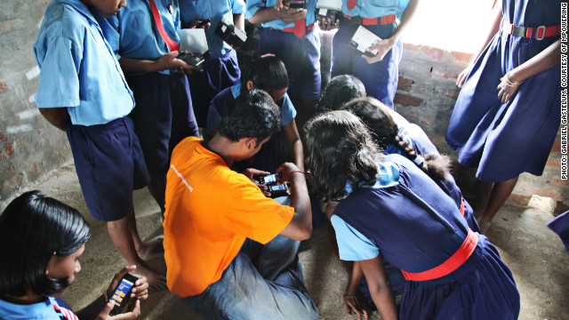 Sharing one smartphone per family, the children earn points for attending school and mothers for attending preventative healthcare classes.
