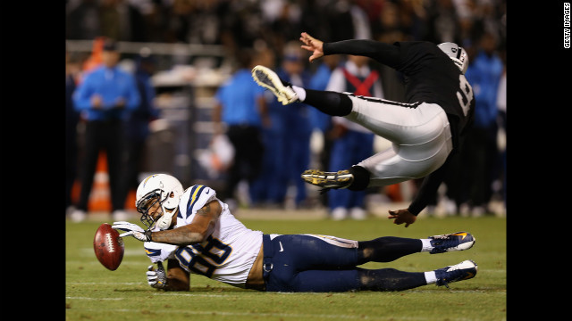 Dante Rosario of the San Diego Chargers blocks a punt attempt by Shane Lechler of the Oakland Raiders.