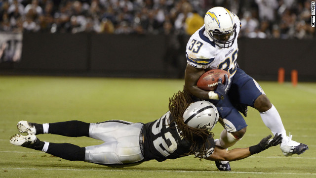 Le'Ron McClain of the San Diego Chargers is tackled by Philip Wheeler of the Oakland Raiders in the fourth quarter of the season opener.