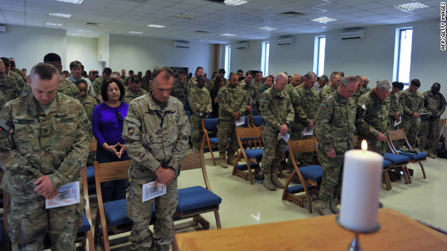 Soldiers with the NATO-led International Security Assistance Force pray during a memorial ceremony in Kabul, Afghanistan, on Tuesday, September 11.