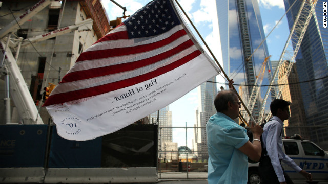 Germano Riviera carries the Flag of Honor, which displays the names of the victims of the September 11 attacks, across ground zero on Monday.