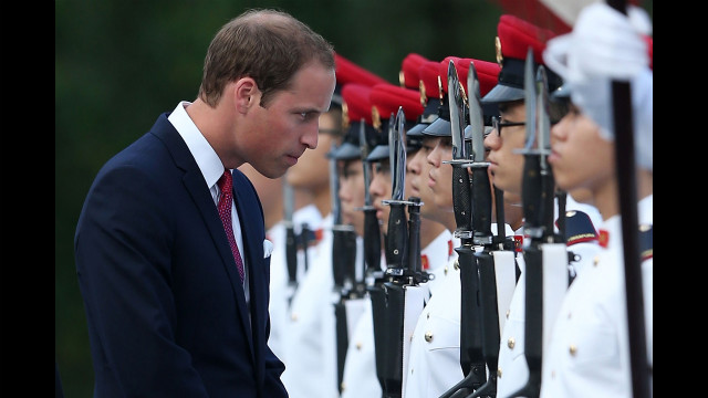 William stops to speak to an honor guard on arrival at the Istana, home of Singapore's president and working office of the prime minister, during the Diamond Jubilee tour on Tuesday.