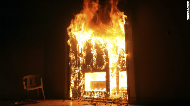The U.S. Consulate in Benghazi is set on fire during a protest. Armed gunmen attacked the compound on Tuesday evening, clashing with Libyan security forces before the latter withdrew as they came under heavy fire. 
