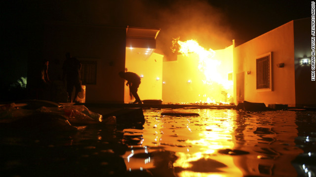 People duck flames outside a consulate building on Tuesday. &lt;a href='http://www.cnn.com/2012/09/11/middleeast/gallery/cairo-embassy/index.html'&gt;Photos: Protesters storm U.S. Embassy buildings&lt;/a&gt;