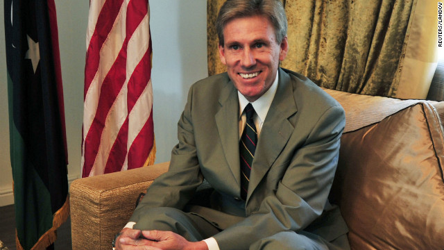 Ambassador Christopher Stevens, smiles in this file photo taken at his Tripoli, Libya, home in June.