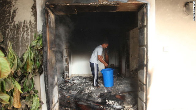A man stands in part of a burned-out building of the U.S. mission on September 12.