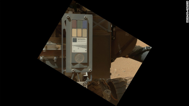 This is the calibration target for the MAHLI. This image, taken on September 9, shows that the surface of the calibration target is covered with a layor of dust as a result of the landing. The calibration target includes color references, a metric bar graphic, a penny for scale comparison, and a stair-step pattern for depth calibration.