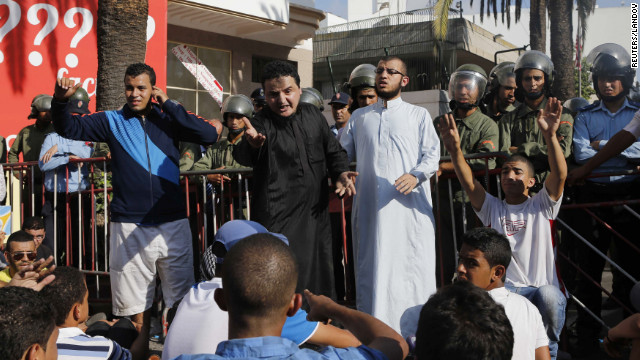 Police confront protesters praying in front of the U.S. Embassy in Casablanca, Morocco, during a rally against the anti-Islam film on Wednesday.