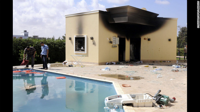 People inspect the damage at the U.S. Consulate in Benghazi, Libya, on September 12.