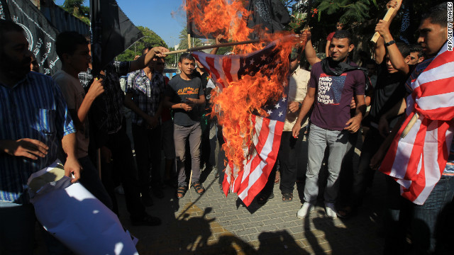 Palestinian men burn the American flag during Wednesday's demonstration in Gaza City.
