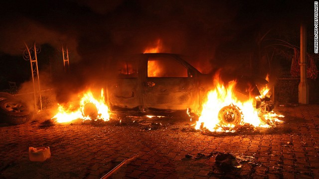 A vehicle and the surrounding area are engulfed in flames after it was set on fire inside the compound on September 11.