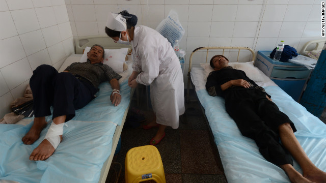 Injured villagers at the Yiliang People's Hospital lie on beds on Monday, September 10, receiving care for injuries after a series of earthquakes hit Yiliang County, Yunnan Province, on Friday. 