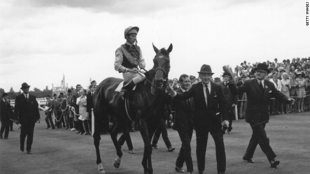 The last horse to win the Triple Crown was Nijinsky in 1970, seen here being led at Ascot by a different O'Brien -- legendary trainer Vincent.