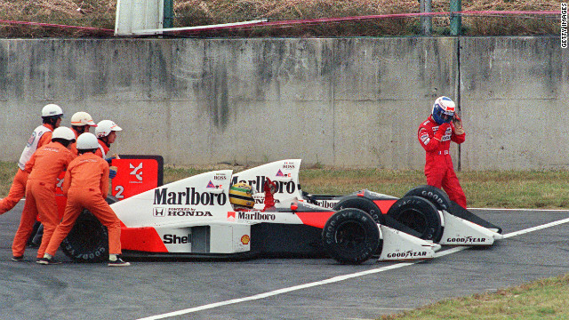 Senna is given a push for a restart while Prost abandons the race after the supposed teammates collided during the Japanese Grand Prix in 1989.