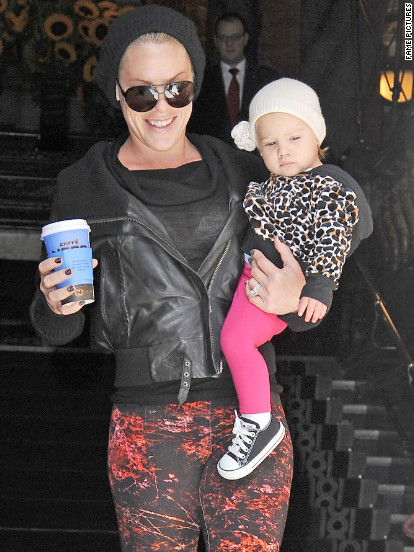 Pink leaves her London hotel with her daughter Willow.