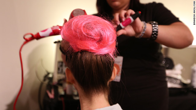 "It takes five tries to tame Vujevic's long, wavy hair into a ""punky ballerina bun"" for Avril Lavigne's runway show."