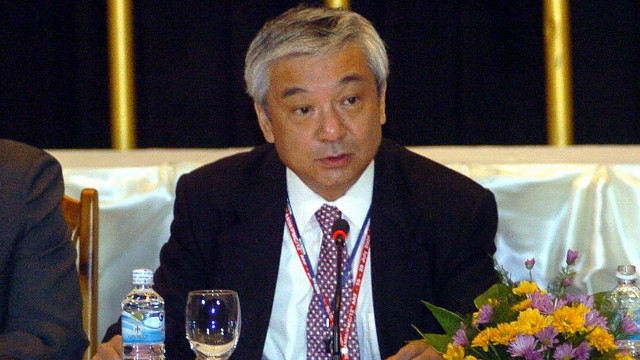 Shinichi Nishimiya (C) pictured in 2005 at a meeting of the Association of Southeast Asian Nations (ASEAN).