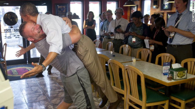 Obama is lifted up by Scott Van Duzer, owner of Big Apple Pizza and Pasta Italian Restaurant, during a visit to the restaurant in Fort Pierce, Florida, on Sunday, September 9. Obama was on a two-day bus tour across the state.