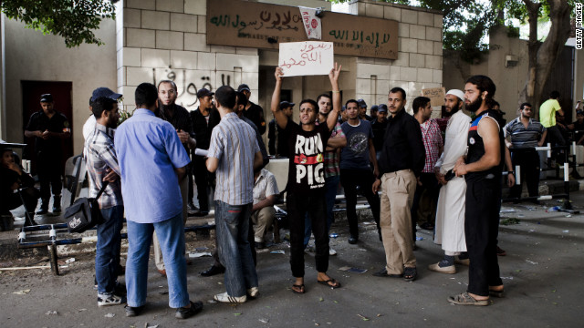 Egyptian protesters gather in front of the U.S. Embassy the morning after it was vandalized by protesters during a<br />