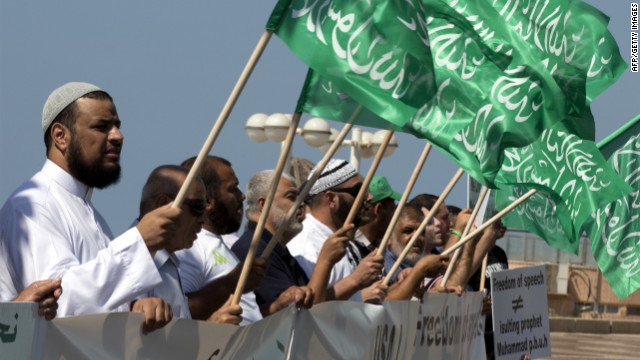 Arab-Israeli men wave green Islamic flags with the Muslim profession of belief: &quot;There is no God but God and Mohammed is the prophet of God&quot; during a protest in front of the U.S. Embassy on Thursday in Tel Aviv, Israel.