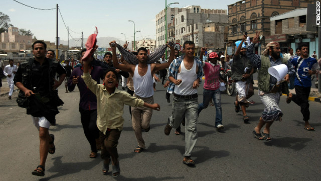 Protesters chant slogans during a march to the U.S. Embassy in Sanaa, Yemen, on Thursday, September 13. One protester was killed in clashes when Yemeni security forces dispersed hundreds of demonstrators who gathered around and inside the U.S. Embassy in Sanaa as part of widespread anger in at least 11 countries over a film ridiculing Islam's Prophet Mohammed.