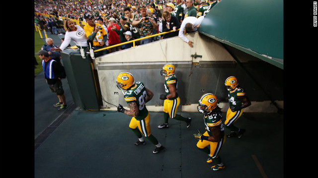 Tight end Tom Crabtree of the Green Bay Packers, left, leads teammates onto the field for warm-ups before their game against the Chicago Bears. Look back at Week One of the NFL.