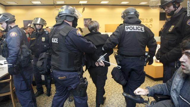 Portland Police arrest a demonstrator inside a Wells Fargo Bank branch November 17, 2011, in Portland, Oregon.