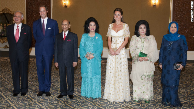 Malaysian PM Najib Razak; Britain's Prince William; Malaysia's king Sultan Abdul Halim Mu 'adzam Shah and his wife Queen Haminah Hamidun; Britain's Catherine, Duchess of Cambridge; and Razak's wife, Rosmah Mansor pose for a picture during an official dinner at the royal residence, the Istana Negara, in Kuala Lumpur on September 13.