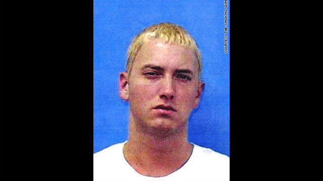 Marshall Mathers, aka Eminem, was booked on gun charges twice in June 2000. Police said both arrests stemmed from fights -- the first over his estranged wife, Kim, and the second against rival rap group Insane Clown Posse.