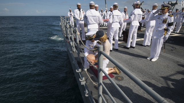 U.S. Navy Lt. Cmdr. Paul Nagy and Carol Armstrong, wife of Neil Armstrong, drop the remains of Neil Armstrong in the Atlantic Ocean.