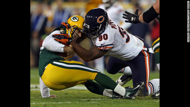 Chicago Bears defensive end Julius Peppers sacks Green Bay Packers quarterback Aaron Rodgers in the first quarter Thursday.